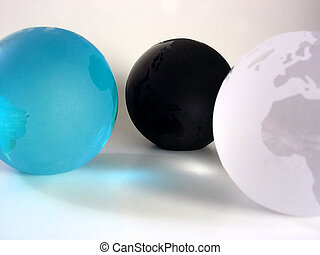 Colorful Globes - Three crystal globes, each a different...
