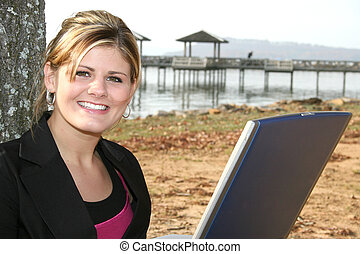 Woman Computer Park - Beautiful young woman working on...