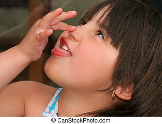 Funny Face - Little girl touching her nose with her finger...