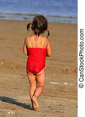 Wandering Towards The Sea - Rear view of a little girl in a...
