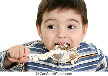 Boy Child Possum Pie - Close up of a two year old boy eating...