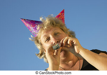 woman from birhtday party - woman with noisemaker from...