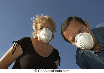 man and woman in masks - ecologists