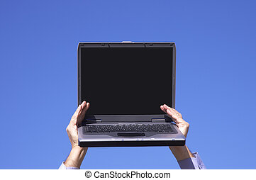laptop in hands - laptop with empty screen