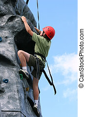 Determined to Succeed - A boy climbing and stretching and...