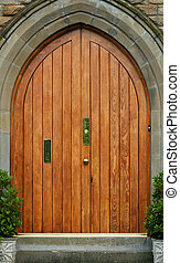 The Doorway - Old wooden oak stone arched doorway with and...