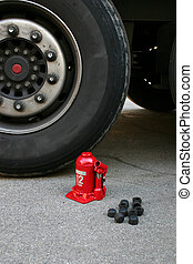 Truck tire with lifting jack - Truck tire with red lifting...