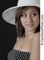Cute girl with dimples in white hat