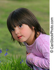 Inquisitive Child - Face and upper body of a little girl...