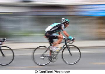 Bike Racer #3 - An intentional slow-shutter blur, gives this...