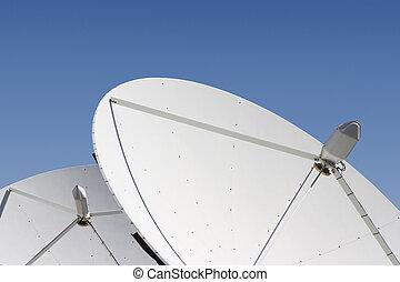 Satellite Dish #6 - Two satellite dishes point skyward.