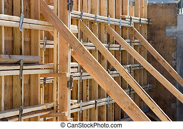 Construction Supports - Wooden supports hold up a wall at a...