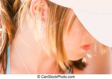 Feminine Dream - A side view of part of a womans face....