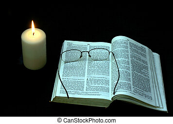 Evening Bible study - Candle lit Bible study, with glasses.