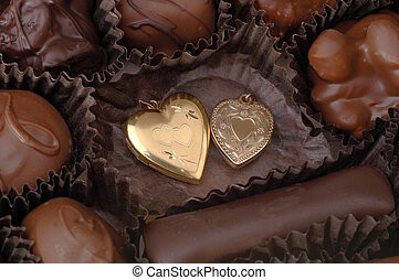 Chocolate and Gold Hearts - Two gold hearts among handmade...