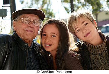 Three generations - Girl, her mother and grand father
