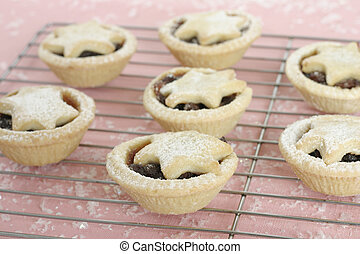 Fruity mince pies - Fruity mince tarts on cake cooler, focus...