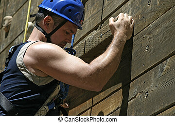 Biceps With Effort - A climber, on a practice wall, shows...