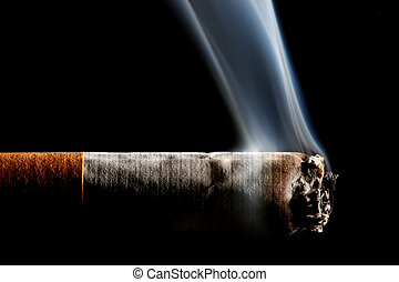 cigarette smoking - macro of a smoking cigarette from the...