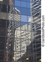 Downtown Reflections - Buildings reflected in the glass face...
