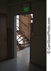 Exit Door - An doorway with an exit sign above it leads to a...