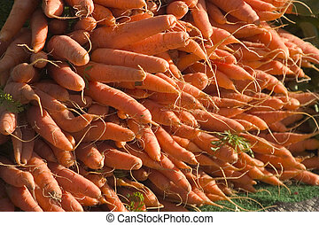 Stack of Carrots - A stack of organic carrots at a street...
