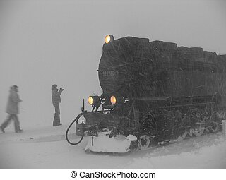 Old times - Steam engine showing through the blizzard