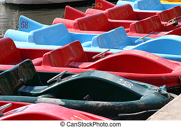 A Line of Pedalos - 7 Pedalo Boats on the River Dee In...