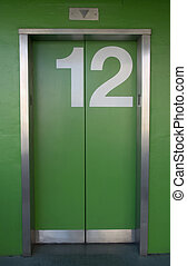 Green Elevator - A green elevator with the number twelve...