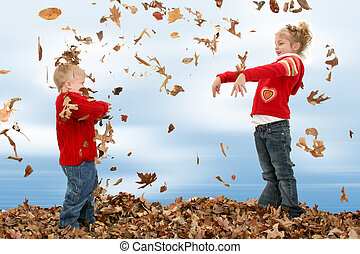 Boy Girl Leaves - Happy two year old boy and five year old...