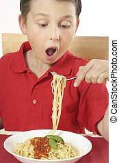 Child eating spaghetti - Boy with spaghetti noodles and...