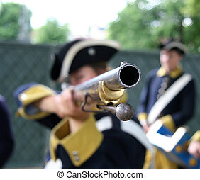Old type rifle - Soldier aiming with a old type rifle