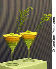 Quirky Cocktails - Two cocktail glasses standing on a cloth...