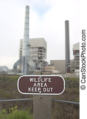Industrial Irony 2 - A wildlife area contains a large...