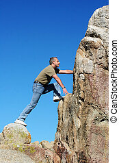 Climbing to the top - Man climbing to the top of the...