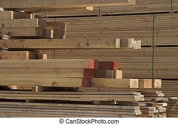 Lumber - A pile of lumber at a lumberyard.