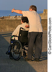 Caring for the Disabled - Elderly disabled woman in a...