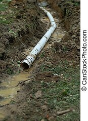 French Drain Outlet - French drain outlet - being installed