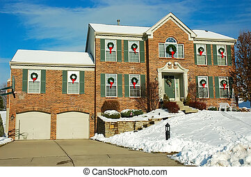 House in Winter - Two story brick American house sitting on...