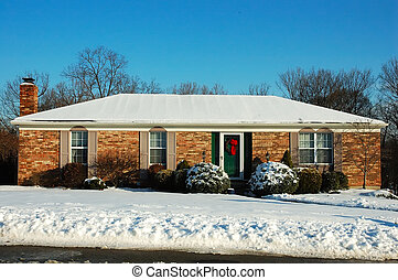 Ranch House in Winter - Single story brick American house...