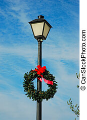 Lamp Post with a holiday wreath against the brilliant blue...