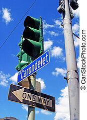 Stoplight - A green stoplight above a one way sign