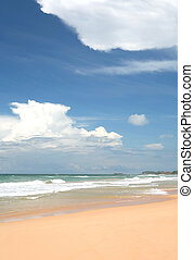 Tropical skies - Dramatic clouds over a tropical beach in...