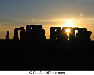 Stonehenge Sunset - Sun setting over the famous English...