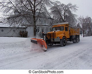 Clearing Roads - Bulldozer, dozing snow off the roads after...