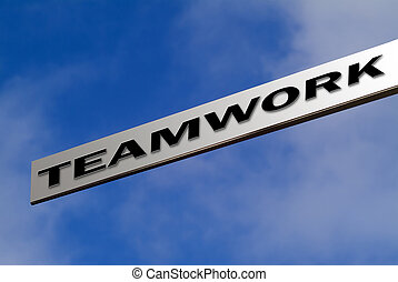 Teamwork sign - Blank aluminium finger sign against blue sky...