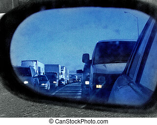 in the sideview - stuck in usual 401 westbound rush hour...