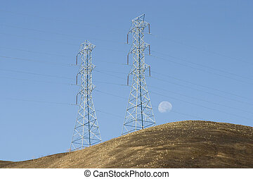 Moon Power - Hight voltage lines are held aloft by giant...