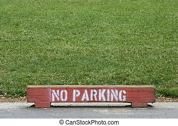 No Parking - A wooden marker warns against parking near the...