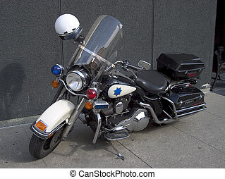 Police Motorcycle - A fancy police motorcycle sits parked on...